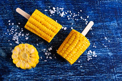 Cut corn on the cob on a stick Royalty Free Stock Images