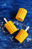 Cut corn on the cob on a stick Royalty Free Stock Photography