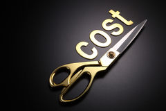 Cut cost. Golden scissors with the text cost Royalty Free Stock Image