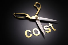Cut cost. Golden scissors with the text cost Stock Images