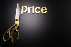 Cut cost. Golden scissors with the text cost and price Stock Photography