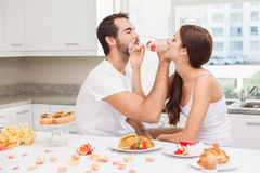 Cut couple drinking champagne together Royalty Free Stock Image