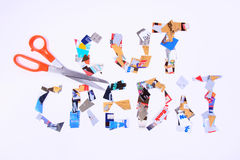 Cut Credit Cards. Cut up credit cards with a pair of scissors spelling out cut credit Royalty Free Stock Photos