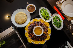 Cut Crispy Peking duck with pancakes Royalty Free Stock Photo