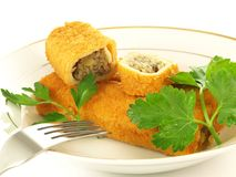 Cut croquette. Croquette with cabbage and muschrooms on a plate Stock Photos