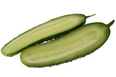 The cut cucumber. The cucumber cut lengthways on the white isolated background Royalty Free Stock Photo