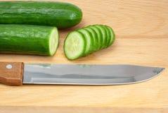Cut cucumber on hardboard Royalty Free Stock Photo
