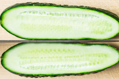 Cut the cucumber slice along the knife Royalty Free Stock Photography