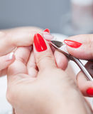 Cut cuticle on the female forefinger Stock Photos