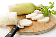 Cut daikon radish Stock Photos