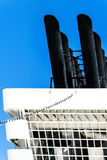 Cut detail of a ship chimney in white and black against a blue s Stock Image