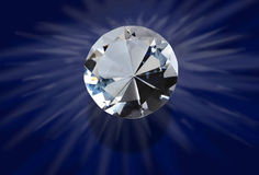 Cut diamond. Details of a large, round, cut diamond, on a dark blue background Stock Image