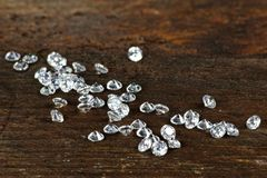 Cut diamonds. On wooden background Royalty Free Stock Photos