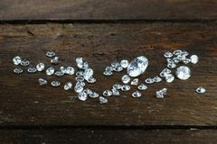 Cut diamonds. On wooden background stock photography