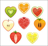 Cut of differend fruits and berries in the shape of a heart.White background. Stock Photo