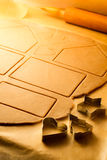 Cut different shapes of gingerbread cookies Royalty Free Stock Photos