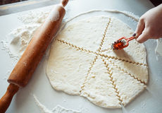 Cut dough with a knife Royalty Free Stock Photo