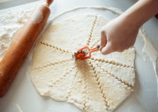 Cut dough with a knife Royalty Free Stock Photography