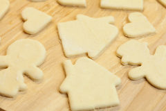 Cut in the dough snowman, heart, and  house Royalty Free Stock Images