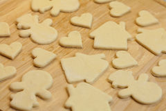 Cut in the dough snowman, heart, and  house Stock Photography