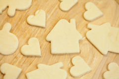 Cut in the dough snowman, heart, and  house Stock Photo