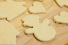Cut in the dough snowman, heart, and  house Royalty Free Stock Photos