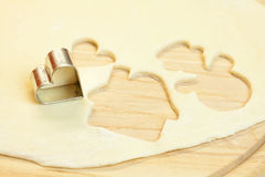 Cut dough snowman, house, heart Royalty Free Stock Images