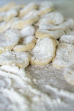 The cut dough to floured rolling. Stock Photos
