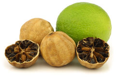Cut dried white lime fruit and a fresh one Royalty Free Stock Photos