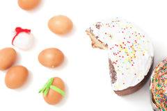 Cut and Easter colored eggs on a white background Royalty Free Stock Photography
