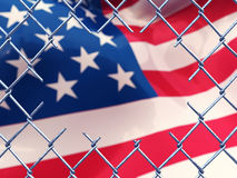 Cut fence and american flag Royalty Free Stock Images