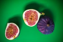 Cut fig on green Royalty Free Stock Images