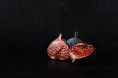 Cut Figs on Black Slate Stock Image