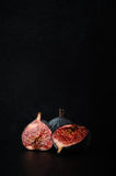 Cut Figs Composition on Black Slate Stock Photos