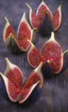 Cut figs like fires. On black board Stock Photography