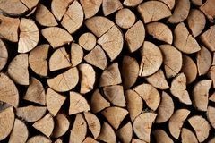 Cut firewood stack logs as pattern Royalty Free Stock Photos