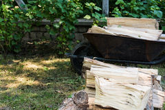 Cut firewood in wheelbarrow Stock Image