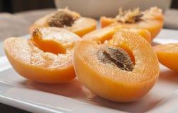Cut fresh apricot Stock Photos
