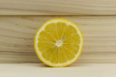 Cut fresh juicy natural sour lemon on wooden background Royalty Free Stock Image