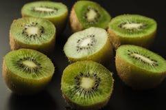 Cut fresh  kiwi against black background/cut fresh kiwi against black background. selective focus stock photo