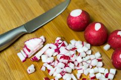 Cut fresh radishes to prepare a variety of dishes.  Royalty Free Stock Images
