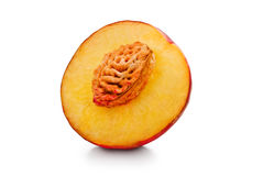 Cut fresh red peach. Isolated on white background royalty free stock photography