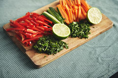 Cut fresh vegetables on a wooden board Stock Photos