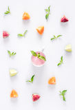 Cut fruit pattern with mint and smoothy white desk background top view Royalty Free Stock Photos
