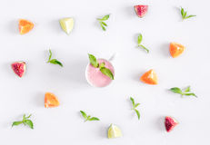 Cut fruit pattern with mint and smoothy white desk background top view Royalty Free Stock Photo
