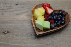 Cut fruits in heart shaped plate Stock Photo