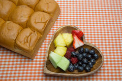 Cut fruits in heart shaped plate Stock Image