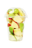 Cut Fruits in Plastic Cup. Mixed Cut Fruits in Plastic Cup on White Background royalty free stock photos