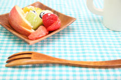 Cut fruits in a wooden plate Stock Photo