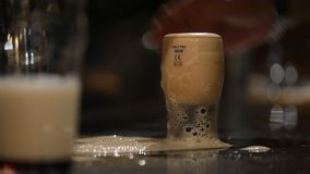 Cut glass of beer in the pub stock video footage